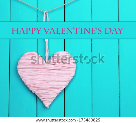 Decorative heart on wooden background - stock photo