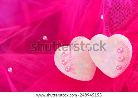 Decorative hearts on pink fabric background, Valentine day