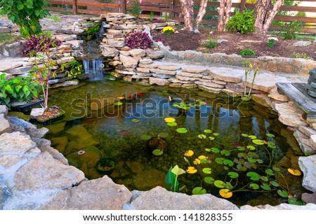 Decorative koi pond in a garden - stock photo