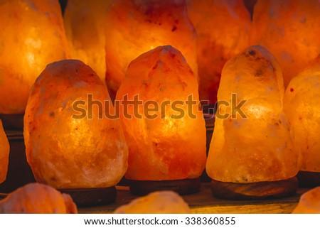 decorative lamp and energetic salt, Himalayan salt - stock photo