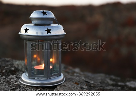 Decorative lamp on rock in mountains