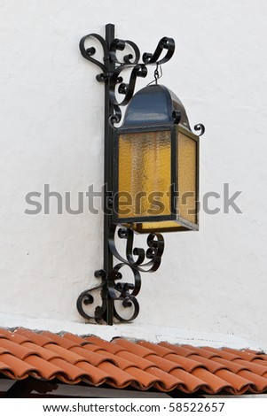 Decorative lantern on a wall in old Puerto Vallarta, Mexico - stock photo