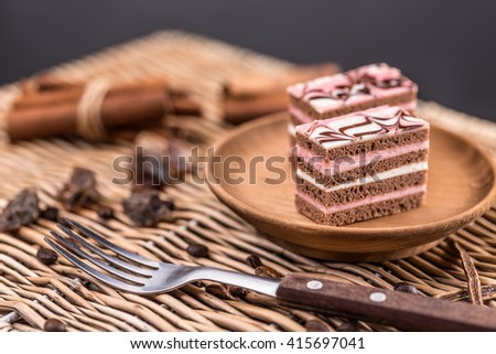 Decorative layered desserts on white plate - stock photo