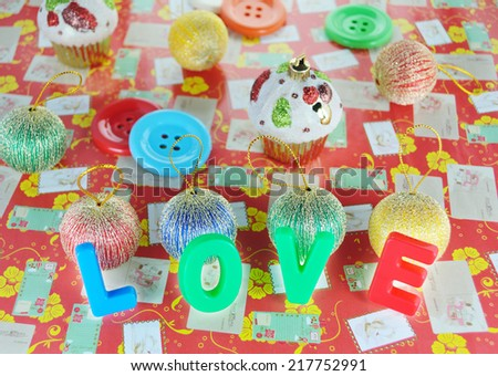 Decorative letters forming word LOVE on colorful background