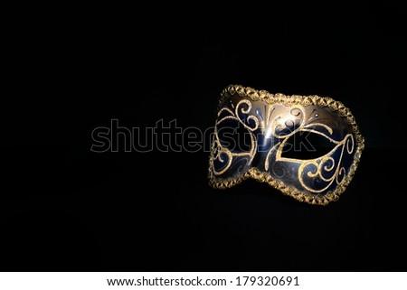 Decorative mask on black background - stock photo