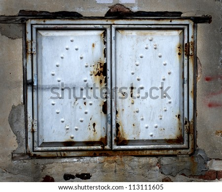 Decorative metal window on an old concrete wall. - stock photo