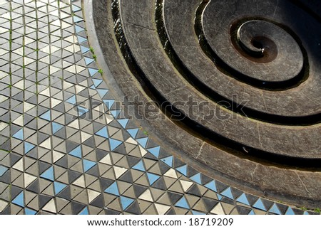 Decorative mosaic paving and circle shaped fountain in Cologne, Germany