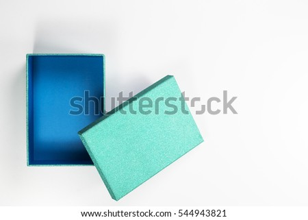 Decorative Open Small Flat Turquoise Box with Blue Inside on White Background.   Top View.