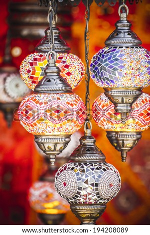 Decorative, Oriental style lamps craft in a bazaar - stock photo