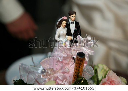 decorative pair of newlyweds on top of a wedding cake