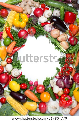 Decorative pattern of fresh vegetables on white background. - stock photo