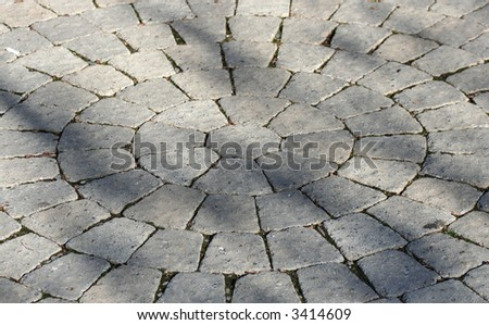 Decorative pavers in a circular pattern. - stock photo