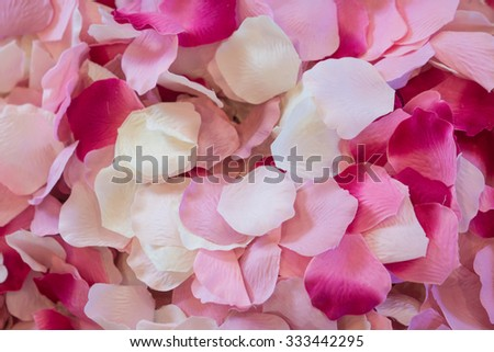 Decorative petals from a wedding reception in a pink pile. - stock photo