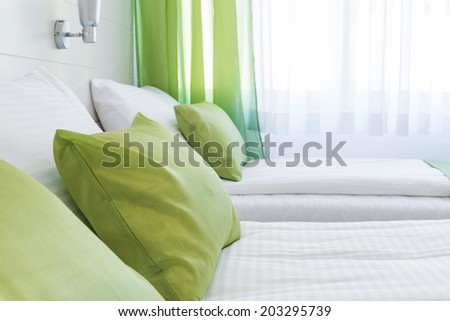 Decorative pillow on bed - stock photo