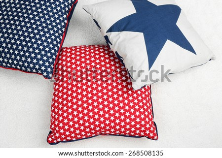 Decorative pillows on plaid close up - stock photo