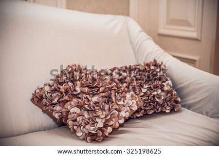 decorative pillows with a pattern on a big sofa - stock photo