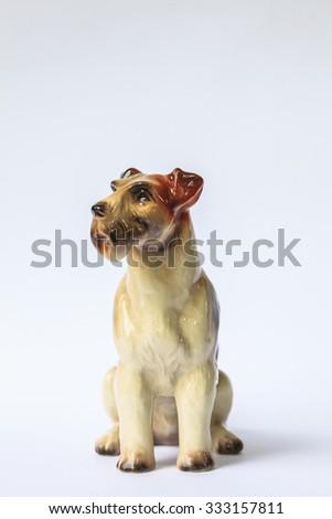 Decorative porcelain dog isolated on white - stock photo