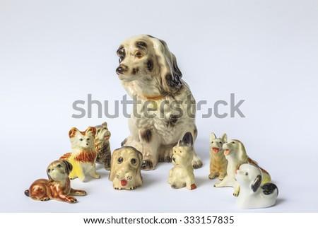 Decorative porcelain dogs isolated on white - stock photo