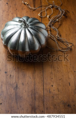 Decorative pumpkins on a dark wooden background. Copy space.