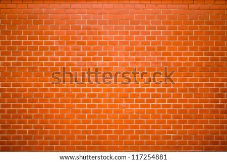 Decorative red brick wall surface - stock photo