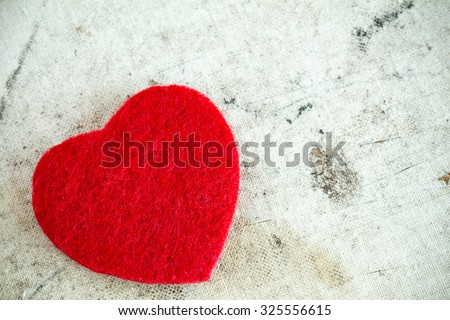 Decorative red heart on dirty background with copy-space - stock photo