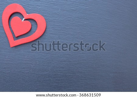 Decorative red hearts of different sizes. Grey ribbed background, copy space, isolated - stock photo