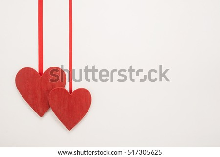Decorative red ribbon and heart on a white background