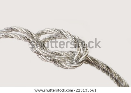 Decorative rope with a loop, knot - stock photo