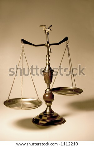 Decorative scale / balance with wooden accents and an eagle on top.  Bronze background. - stock photo