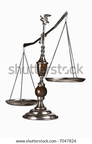 Decorative scale / balance with wooden accents and an eagle on top.  Isolated on white. - stock photo