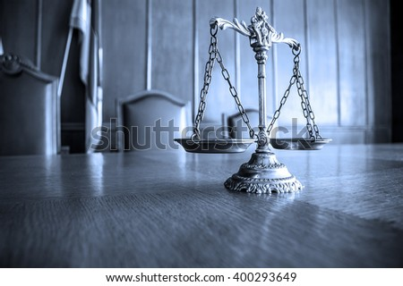 Decorative Scales of Justice on the table. Focus on the scales, BLUE TONE