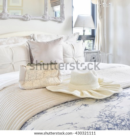 Decorative set with vintage bag,hat,books on bed in luxury bedroom interior