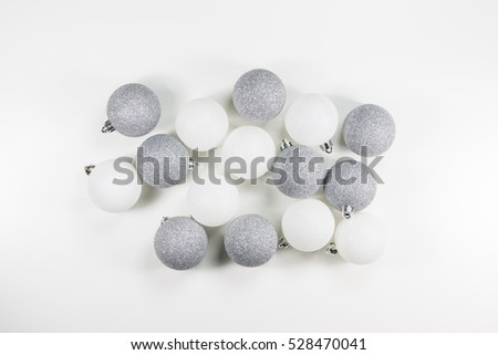 Decorative Silver Christmas Baubles on White Background. Top View.