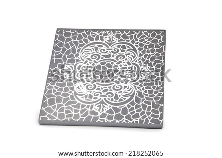 Decorative silver table coaster isolated on white - stock photo