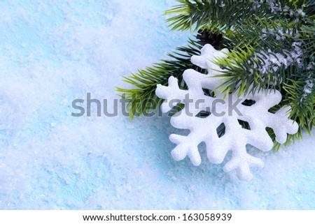 Decorative snowflake and fir tree on light background - stock photo