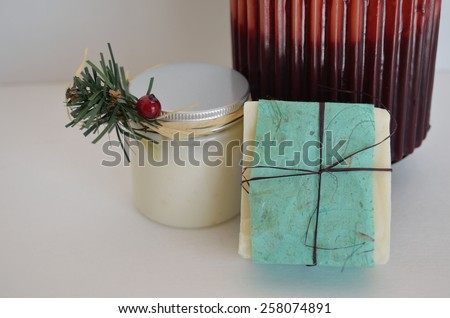 Decorative soap and candle with base of candle - stock photo