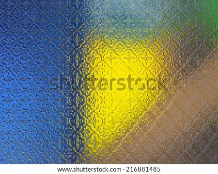 Decorative stained window glass with colorful bokeh in backdrop - stock photo