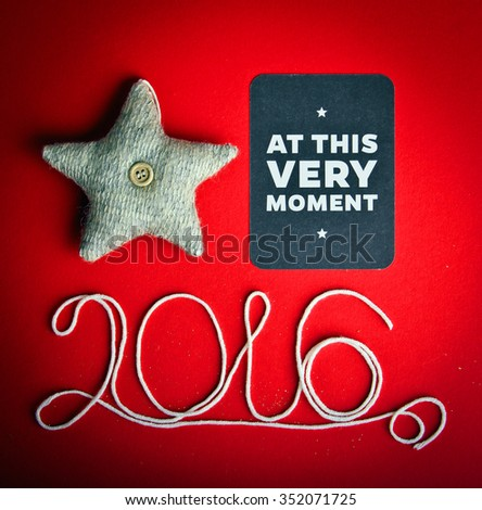 Decorative star on hot red background. Christmas and 2016 New Year theme. Place for your text, wishes, logo. Vignetted. - stock photo