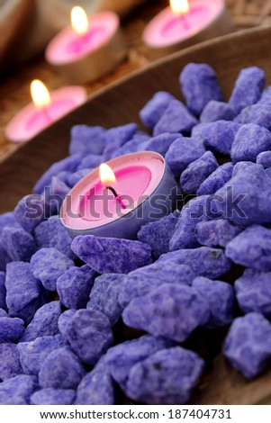 Decorative stones and candles - beautiful composition - stock photo