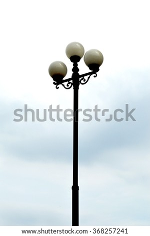 Decorative street lamp-post under blue sky