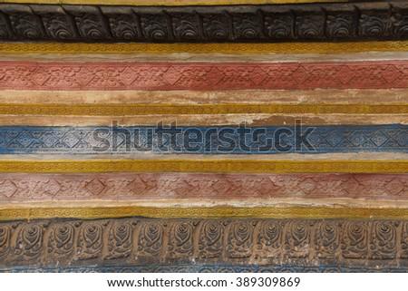 Decorative stucco panels at  Wat Bo Cambodia - stock photo