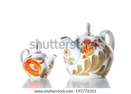 Decorative  tea set  on white background. Ornamental teapots,  Kettles with bright colorful decoration. Tea time. Stylish background. Tableware - stock photo