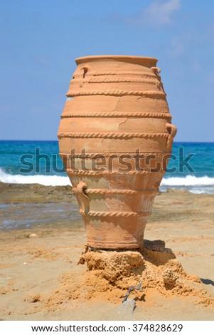 Decorative vase on the Aegean coast in Malia, Crete, Greece. - stock photo