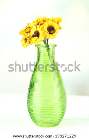 Decorative vase wit flowers isolated on white - stock photo