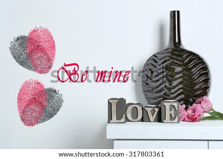 Decorative vase with word Love and fingerprint heart - stock photo