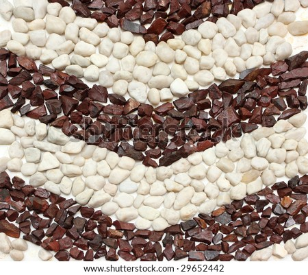 Decorative wall made of red and white round stones - stock photo