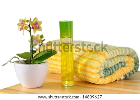 Decorative wellness set with orchid, perfume and towel. Isolated on white. - stock photo