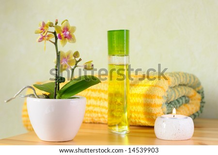 Decorative wellness set with orchid, perfume, towel and candle - stock photo