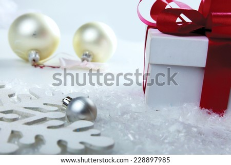 Decorative white gift box with a red bow a background bokeh. - stock photo