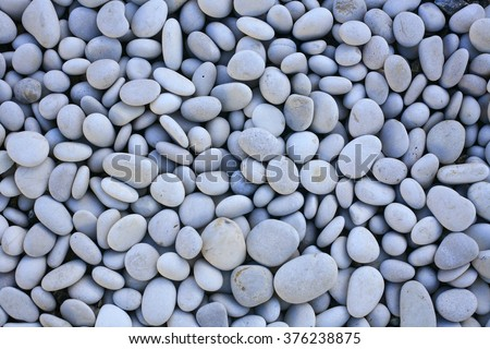 decorative white stones , round stones on white background , Stones or Gravel for building, floor or wall. Seamless Texture. pebbles isolated on a white background - stock photo
